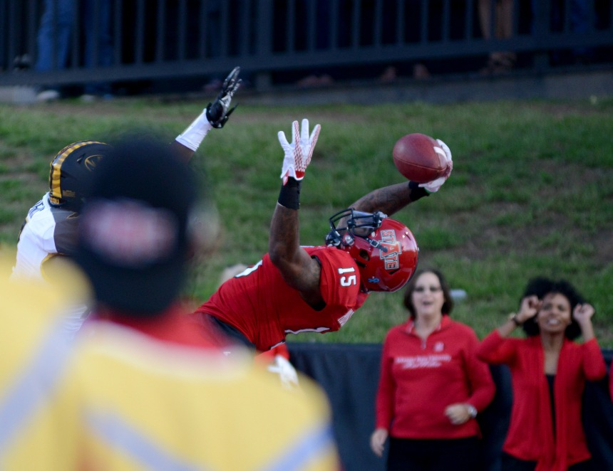 Arkansas State wide receiver Tres Houston, #15, catches a pass  at the game against a Missouri player in the second quarter of their game, September 12, 2015 at Centennial Bank Stadium in Jonesboro, Ark. Missouri defeated Arkansas State University 27-20. | Photo By: Kayla Macomber