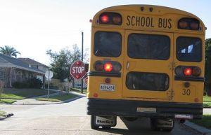 A school bus stops, via Wikimedia Commons