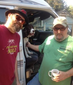 Artist Walter Simon, Jefferson the English Springer Spaniel, and Glynn Wilson of the New American Journal.