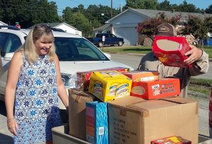Kristie Ford, counselor of Paragoulds Baldwin Elementary School, reacts to the donated supplies. PLWC's Volunteerism Committee makes an annual donation of backpacks and food for local children in need. (Photo by Kimberely Blackburn)
