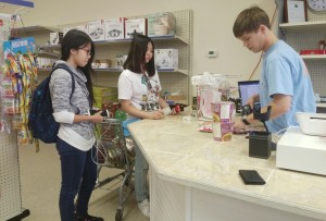 Cashier Jay Chandler totals food costs for A-State International students. The Asian Food Market opened Nov. 1.