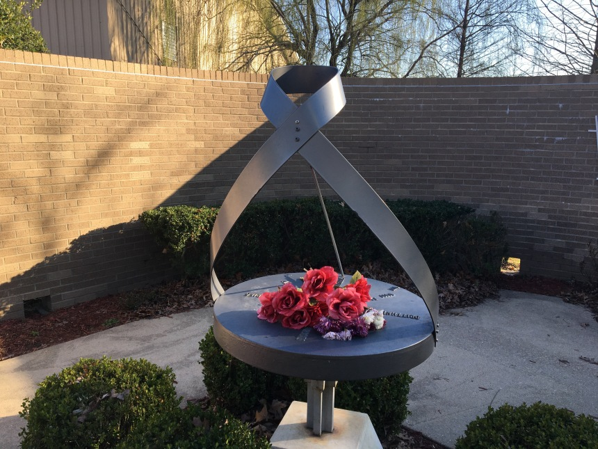 Sculpted sundial by Curtis Steele at Westside Middle School Memorial Garden